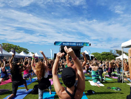 NORTH SHORE, HAWAII - FEBRUARY 26: Yogi snap and move in Farewell: blissed and blessed yoga class a celebration of the power of yoga, community, music and nature outdoors  with Mike love and Eoin Finn at Wanderlust yoga event on the North Shore, Hawaii on