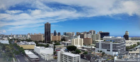 Aerial of  Honolulu, Diamond Head, Waikiki, Buildings, parks, hotels and Condos with Pacific Ocean stretching into the distance on nice day.