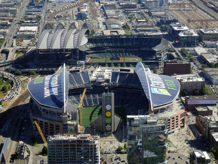 SEATTLE - JUNE 25: Aerial view of CenturyLink, train tracks, buildings, roads and Safeco Field in Seattle in June 25, 2016. Home of the Seattle Seahawks (NFL), Mariners (MLB) and Sounders (MLS). Editorial