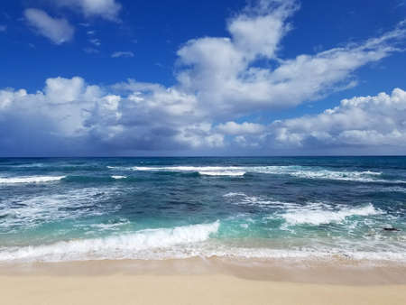 Waves roll towards shore at Camp Harold Erdman Beach which is located on the north shore at the far west end of Oahu. This is the stretch of sandy beach that starts from the west where the Farrington Highway ends and runs east to the YMCA Camp Erdman.