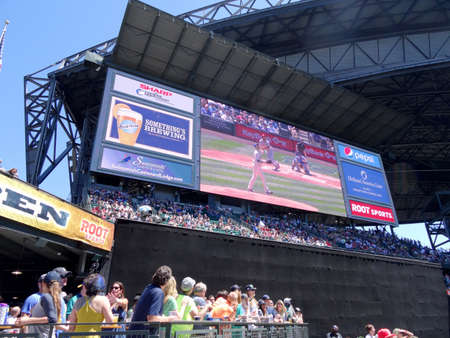 outfield: SEATTLE - JUNE 26: Scoreboard HDTV shows highlights as fans watch at Safeco Field before baseball game, Seattle in June 26, 2016.