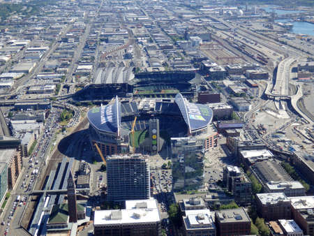 seahawks: SEATTLE - JUNE 25: Aerial view of CenturyLink, train tracks, buildings, roads and Safeco Field in Seattle in June 25, 2016. Home of the Seattle Seahawks (NFL), Mariners (MLB) and Sounders (MLS). Editorial