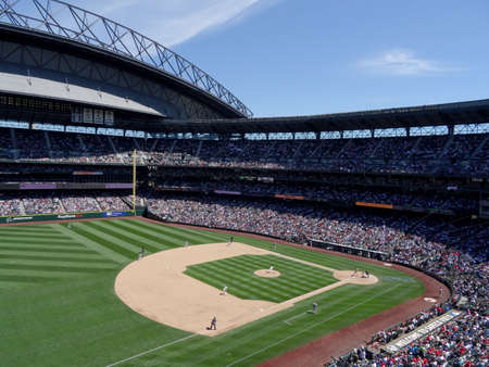 SEATTLE - JUNE 26: Mariners Pitcher steps forward to throw pitch to Cardinals batter with infield in view during baseball game at Safeco Field, Seattle in June 26, 2016.