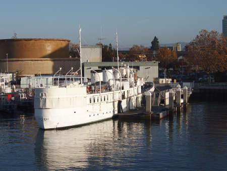"Oakland - November 14, 2011: USS Potomac rest at dock in Oakland Harbor on a clear day. Know as the ""Floating White House"" the USS Potomac served as Franklin Delano Roosevelt's Presidential Yacht until his death in 1945.  Elvis Presley was also once the o"
