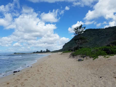 Camp Harold Erdman Beach is located on the north shore at the far west end of Oahu. This is the stretch of sandy beach that starts from the west where the Farrington Highway ends and runs east to the YMCA Camp Erdman.