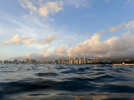 Dramatic Dusk reflects on the water on ocean of Waikiki on Oahu, Hawaii.