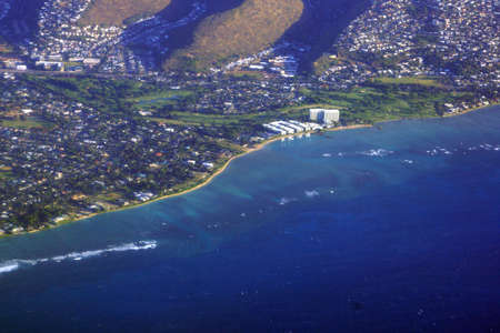 Aerial view of Kahala, and H-1 Highway, Hotel, Pacific ocean, clouds, and Golf Course on Oahu, Hawaii.