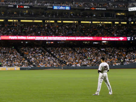 San Francisco - September 27, 2011: Giants right fielder Carlos Beltran stands in the outfield waiting for play during night baseball game on AT&T Park San Francisco. Editorial