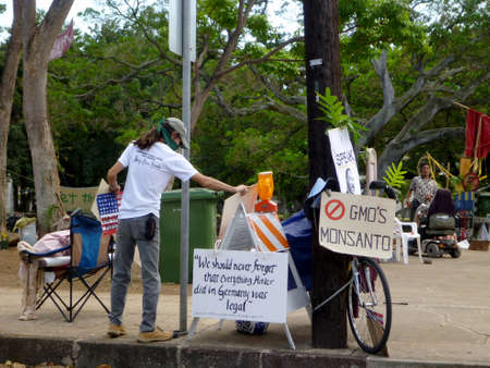 Honolulu - February 2: Protest signs at Thomas Square HPD Police Raid on deOccupy Honolulu encampment February 2, 2012 in Honolulu, Hawaii.