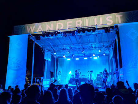 North Shore, Hawaii - March 2, 2018: DJ Drez and Good Crush performs on stage during a evening concert at Wanderlust Yoga festival at Turtle Bay Resort in North Shore, Hawaii. 写真素材 - 128782953