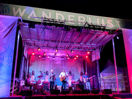 North Shore, Oahu - March 1, 2018:  Ron Artis II & The Truth performs on stage during night concert at Wanderlust Yoga festival taken in North Shore, Hawaii. 写真素材 - 128782954