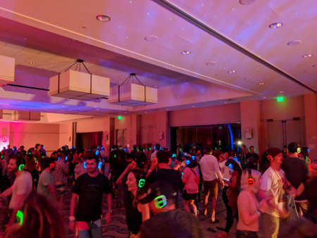 North Shore, Hawaii - March 2, 2018: Silent Disco Dance party at Music festival Wanderlust yoga event on the North Shore, Hawaii.