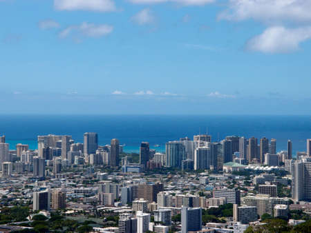 Aerial of  Honolulu, Diamond Head, Waikiki, Buildings, parks, hotels and Condos with Pacific Ocean stretching into the distance on nice day. Taken on August 15, 2013