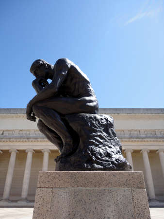 San Francisco - April 8, 2011:  Side profile of the masterpiece the Thinker by Rodin - The Thinker at the entrance of the Palace of the Legion of Honor in San Francisco.       Editorial