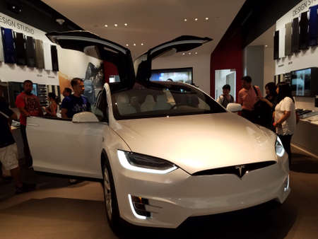 Honolulu - September 11, 2016: People look at model x Car inside Tesla Store.  Tesla, Inc. is an American company that specializes in electric vehicles, energy storage and solar panel manufacturing based in Palo Alto, California.
