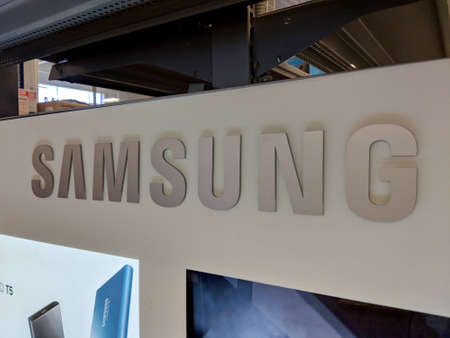 Honolulu - December 14, 2017: Samsung Logo inside Best Buy Store.  Samsung is a South Korean multinational conglomerate headquartered in Samsung Town, Seoul. It comprises numerous affiliated businesses, most of them united under the Samsung brand, and is