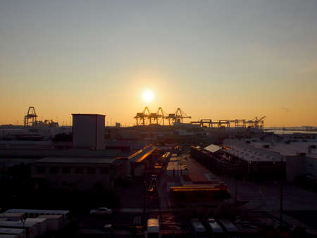 Aerial view of Sunset, Shipping Cranes, and Honolulu cityscape on Oahu, Hawaii January 12, 2016.