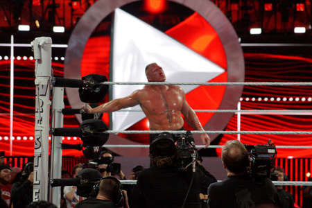 SANTA CLARA - MARCH 29: WWE Champion Brock Lesner bleeds from face during main event match at Wrestlemania 31  as cameramen record  footage at the Levi's Stadium in Santa Clara, California on March 29, 2015. Editorial