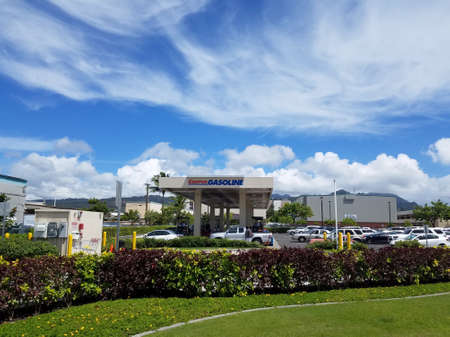 Honolulu - September 28, 2016:  Cars line up for Costco Gasoline. Costco Gasoline Significantly reduces harmful pre-existing deposit buildup on critical engine components. Restores fuel economy. Protects fuel injectors and intake valves from harmful depos Editorial
