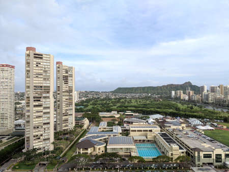 Honolulu - April 21, 2018:  Aerial View of Iolani School with Carnival, condos, Ala Wai Golf Course, Daimond head.  'Iolani School enjoys an inviting campus with wide open spaces, green lawns, places to gather and socialize, and buildings that reflect t Editoriali