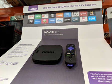 June 1, 2018:  Roku Ultra on display at Costco. The Roku Streaming Player, or simply Roku, is a series of streaming players manufactured by Roku, Inc. Roku partners provide over-the-top content in the form of channels. Stock Photo - 117652724