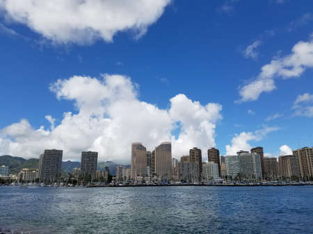 Skyline of Waikiki and Diamond Head during day with yachts and boats in Ala Moana harbor, Hotels, Crane, and Hilton Hawaiian Village framing Diamond Head in Waikiki, Oahu, Hawaii.  2017 Stock Photo