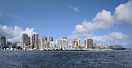 Skyline of Waikiki and Diamond Head during day with yachts and boats in Ala Moana harbor, Hotels, Crane, and Hilton Hawaiian Village framing Diamond Head in Waikiki, Oahu, Hawaii.  2018