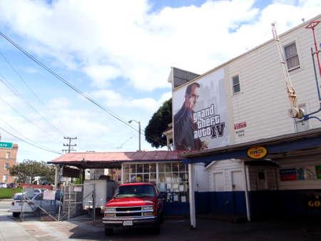 San Francisco - March 6, 2009:  Grand Theft Auto IV Billboard Ad above Car repair shop.