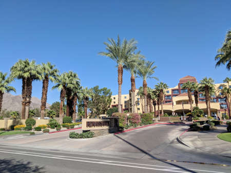 Palm Springs, California, United States - October 26, 2018: Renaissance Palm Springs Hotel entrance. Set against a backdrop of swaying palm trees and the majestic San Jacinto Mountains, this Coachella Valley hotel captures the essence of desert living.