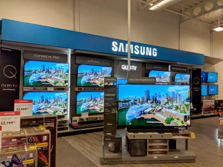 Honolulu -  August 10 2018:  Samsung Logo and TV Display inside Best Buy Store.  Samsung is a South Korean multinational conglomerate headquartered in Samsung Town, Seoul. It comprises numerous affiliated businesses, most of them united under the Samsung
