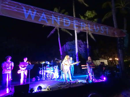 Honolulu - February 28, 2017:  Mike Love Sings into Mic as band jams on stage at Wanderlust Festival on the North Shore of Oahu, Hawaii.