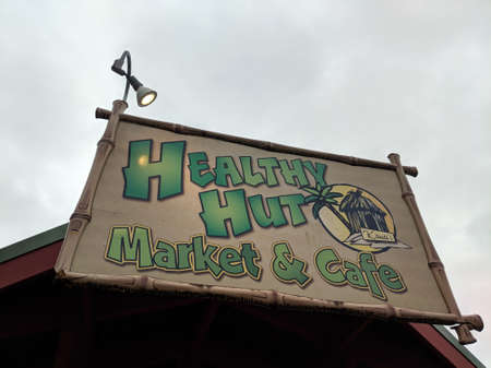 Kauai - April 6, 2018: Healthy Hut - Market and Cafe Sign.  Healthy Hut is located off Kuhio Highway on Ho'okui Road in Kilauea on Kaua'i's North Shore.