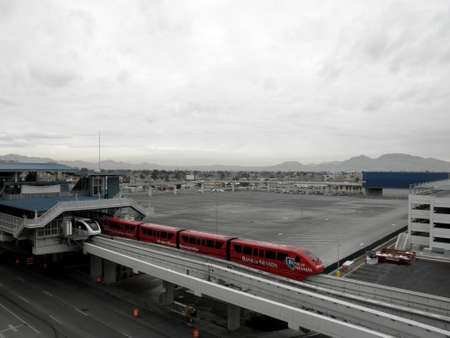 Las Vegas -  February 8, 2010:  Bank of Nevada Train enters SLS Monorail Station on a cloudy day.