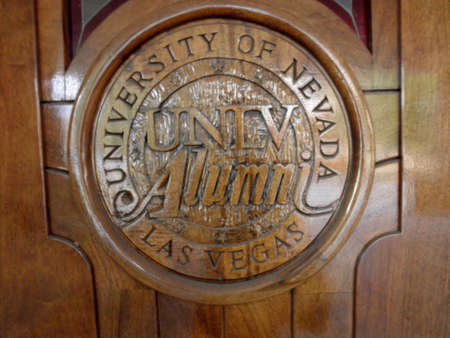 Las Vegas -  February 5, 2010:  University of Nevada, Las Vegas UNLV Alumni emblem on wood door at the Richard Tam Alumni Center. Editorial