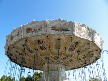 Santa Clara, California - August 7, 2010: Painting Details of Celebration Swing carousel at Great America Park in Santa Clara, California.  Swings spins you in a 70-foot diameter circle at 9 to 11 revolutions per minute, an exhilarating experience for the