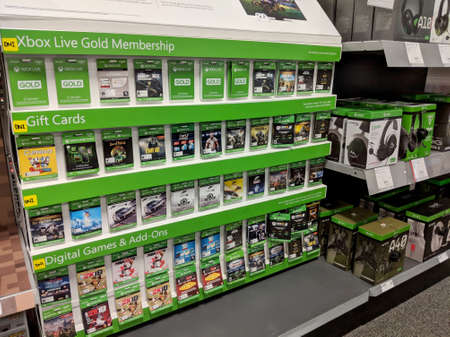 Honolulu -  August 10 2018: Rows of Xbox One Games on display inside Best Buy Store.  Xbox is a video gaming brand created and owned by Microsoft of the United States. It represents a series of video game consoles developed by Microsoft, with three consol