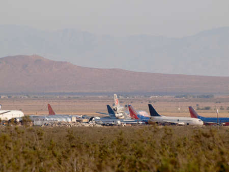 California - August 1, 2011:  Large Boeing, McDonnell Douglas, Lockheed, and Airbus aircraft owned by major airlines parked at storage facility for commercial airliners in the Mojave Air & Space Port. Editorial