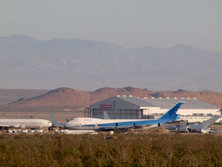 California - August 1, 2011:  Commercial airliners planes parked in the Desert.  Large Boeing, McDonnell Douglas, Lockheed, and Airbus aircraft owned by major airlines parked at storage facility for commercial airliners in the Mojave Air & Space Port.