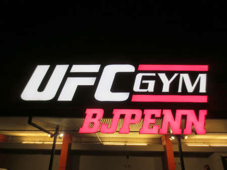Honolulu - March 16, 2013: Sign on Exterior of UFC Gym BJ Penn at night in Honolulu, Hawaii. The gym is part of a chain franchise that offering a full-range of group fitness classes, private MMA training, personal and group dynamic training, plus MMA styl