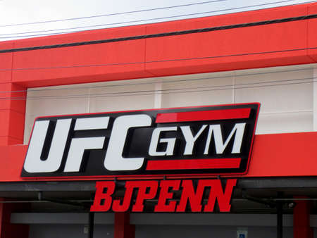 Honolulu - March 14, 2013: Sign on Exterior of UFC Gym BJ Penn in Honolulu, Hawaii. The gym is part of a chain franchise that offering a full-range of group fitness classes, private MMA training, personal and group dynamic training, plus MMA style youth p