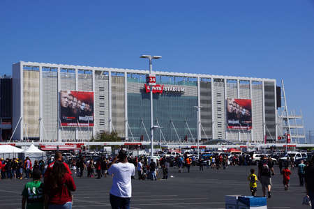 Santa Clara, California - March 29, 2015: People walking to arena and tailgate in parking lot before the start of the showcase of the immortals, Wrestlemania 31, at the Levis Stadium.