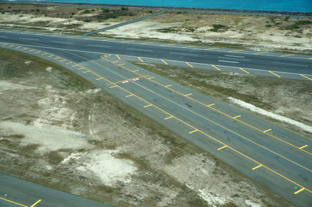 Aerial of Airport Runway at Honolulu International Airport during the day on Oahu, Hawaii.