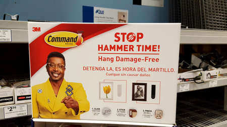 Honolulu - May 10, 2016: 3M Command Brand Stop Hammer Time! Hang Damage-Free Hanging product Ad featuring MC Hammer at Inside Lowe's store.