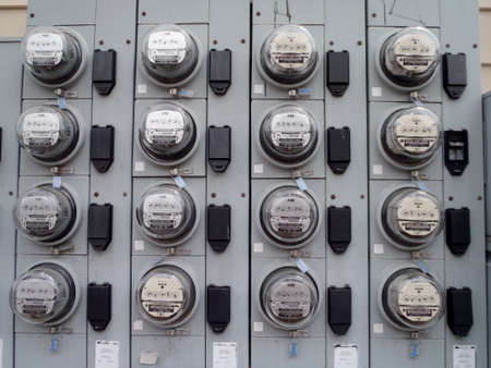 Portland, Maine - May 28, 2010:  Rows of Power Meters on residential building. Meters monitor energy quality and provide real time energy consumption data.