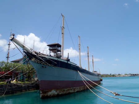 Historic Falls of Clyde Ship sits in Honolulu Harbor. Falls of Clyde is the last surviving iron-hulled, four-masted full rigged ship, and the only remaining sail-driven oil tanker. Designated a U.S. National Historic Landmark in 1989