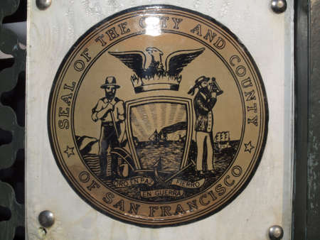 San Francisco - April 30, 2011:  Seal of The City and County of San Francisco on side of trash can.  The seal of the City and County of San Francisco is a coat of arms that includes a shield, crest, supporters and a motto, ringed with the municipalitys n