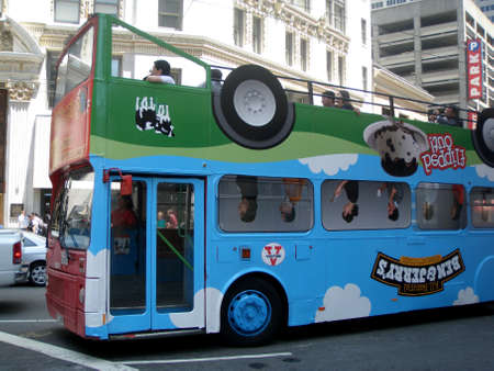 San Francisco - June 26, 2009: Upside-down Ben and Jerry's Ice Cream Ad on Sightseeing Tour Double Deckered Bus as it travels down the street.