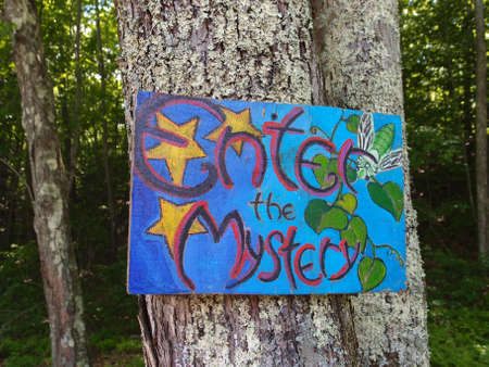 Rhode Island - June 7, 2014:  Enter the Mystery - Sign posted on tree.