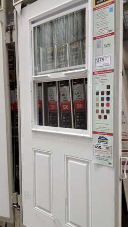 Honolulu - June 12, 2015: Door with Window For Sale Inside Lowe's Home Improvement store. Editorial