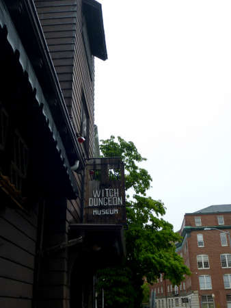 Salem - June 5, 2014:  Witch Dungeon Museum - Sign.  The Musuem features Live reenactment shows of the 1692 Salem witch trial plus tours through a replica dungeon.